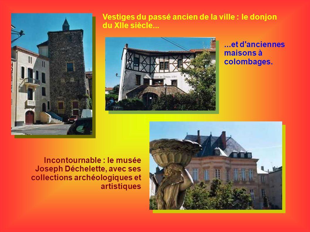 Vestiges du passé ancien de la ville : le donjon du XIIe siècle......et d'anciennes maisons à colombages. Incontournable : le musée Joseph Déchelette,