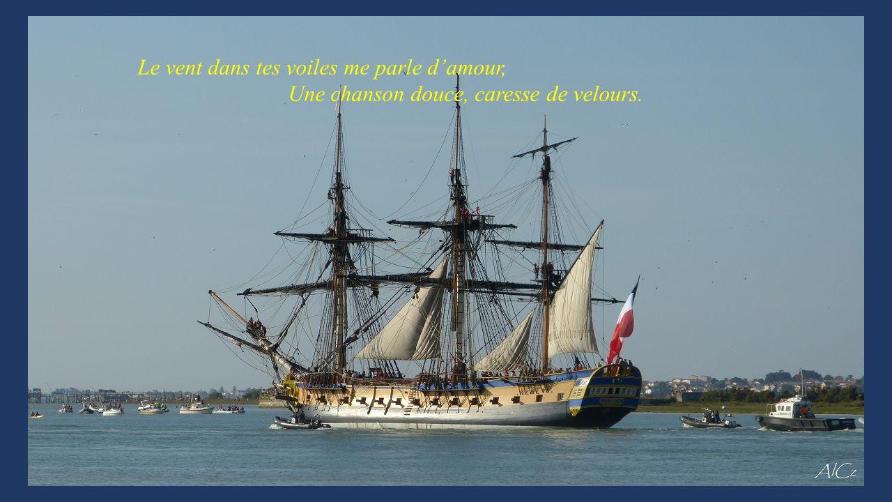 Et vogue, vogue sur l'eau, beau bateau, Tu avances au gré de l'air sur les flots.