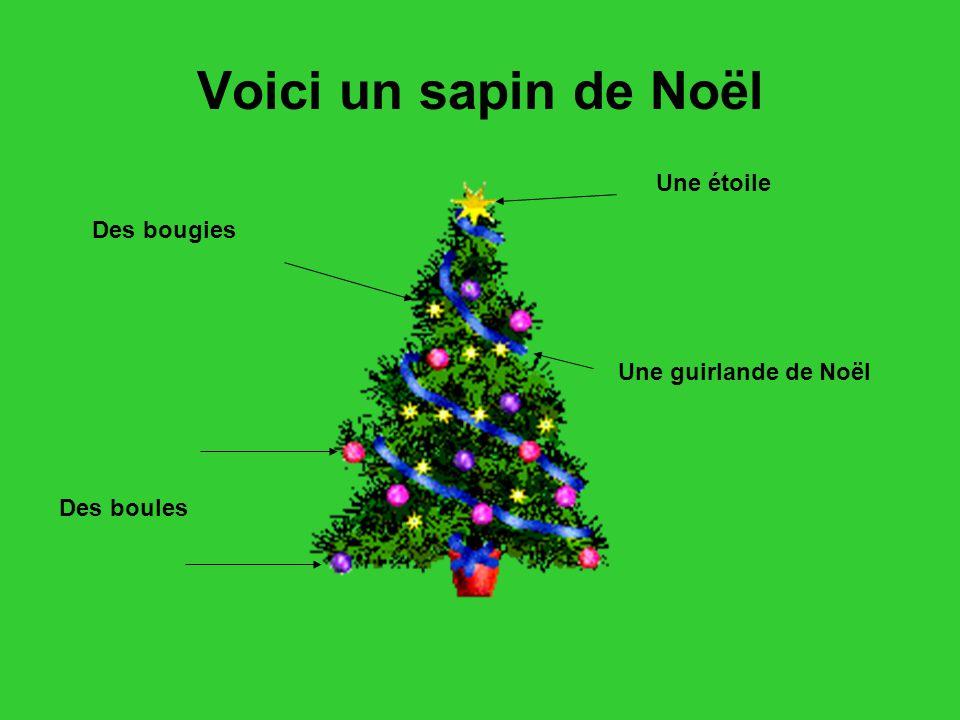 Voici un sapin de Noël Des boules Une étoile Une guirlande de Noël Des bougies