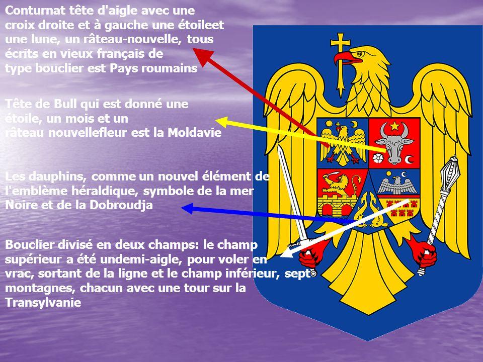 Conturnat tête d'aigle avec une croix droite et à gauche une étoileet une lune, un râteau-nouvelle, tous écrits en vieux français de type bouclier est