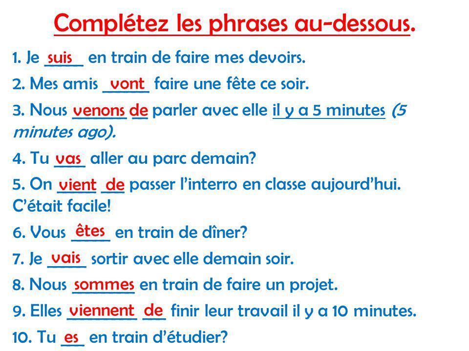 Complétez les phrases au-dessous. 1. Je _____ en train de faire mes devoirs.