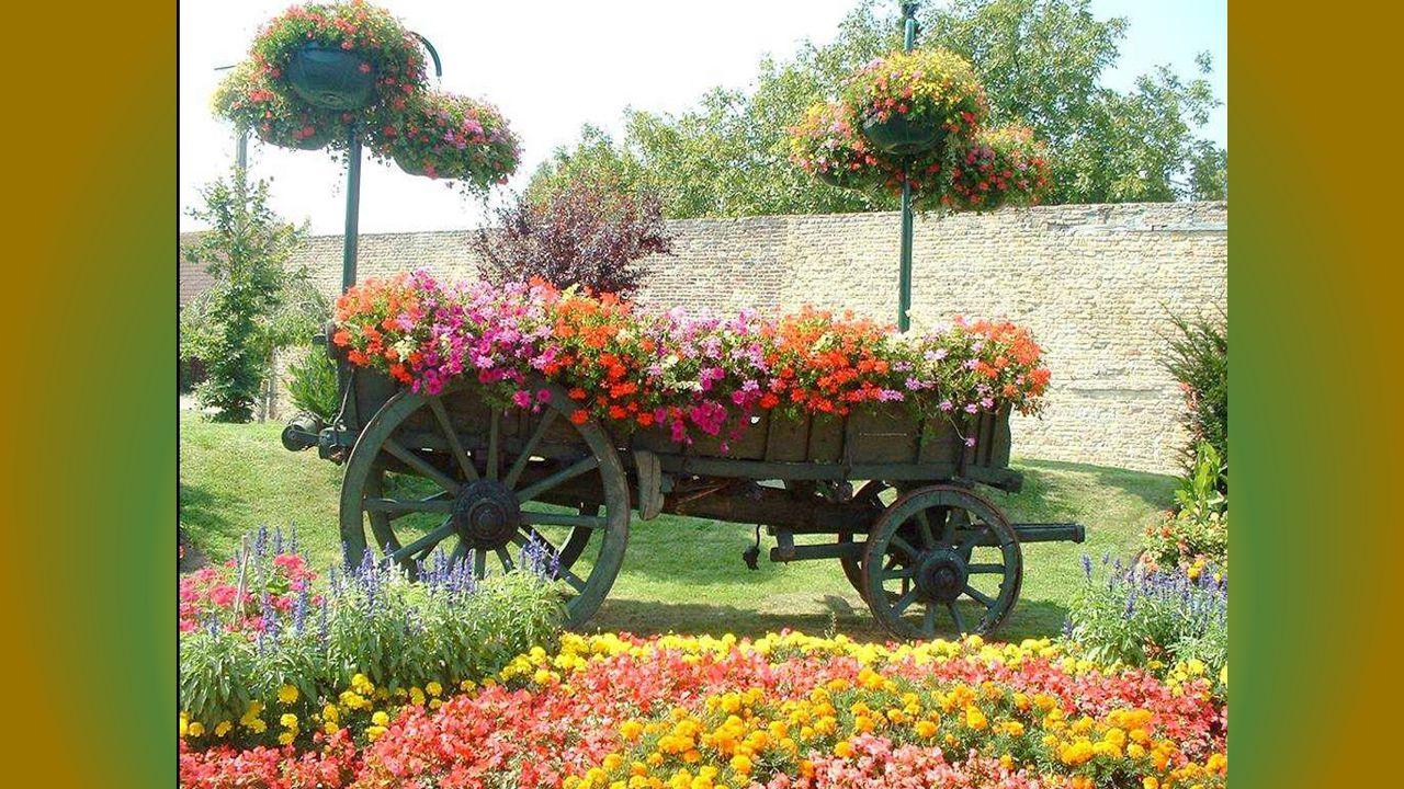 Les grandes roues en bois ont ma préférence, Elles apportent du romantisme et de la poésie Au sourire de la nature en fleurs si jolie.