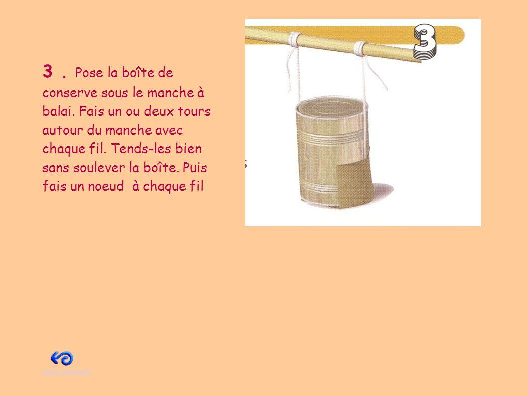 4.Place une boîte de sardines entre le manche à balai et les boîtes de céréales.