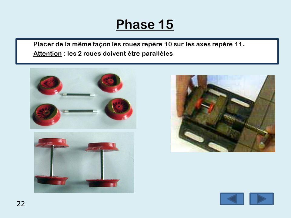 21 Phase 14 Placer les 2 roues avec l'élastique sur l'axe comportant la roue dentée, il est recommandé d'utiliser un étau.
