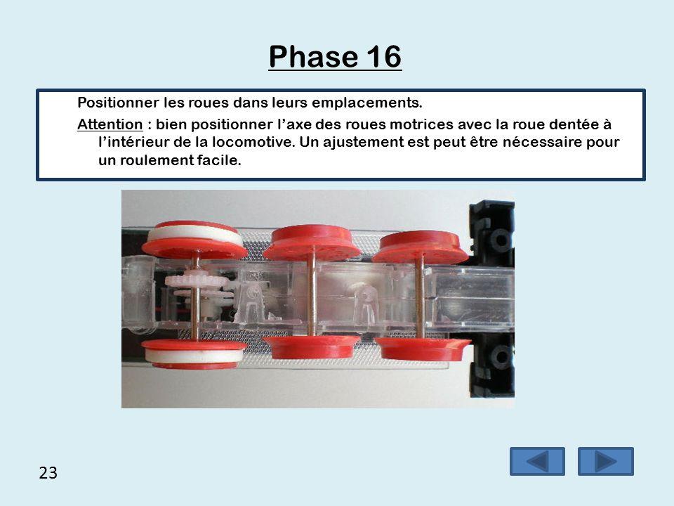 22 Phase 15 Placer de la même façon les roues repère 10 sur les axes repère 11.