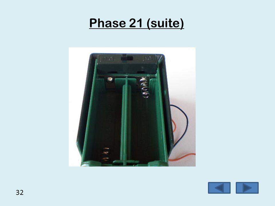 31 Phase 21  Etamer 2 cosses de l'interrupteur,  Braser les fils noir et orange sur l'interrupteur,  Placer l'interrupteur dans son support.