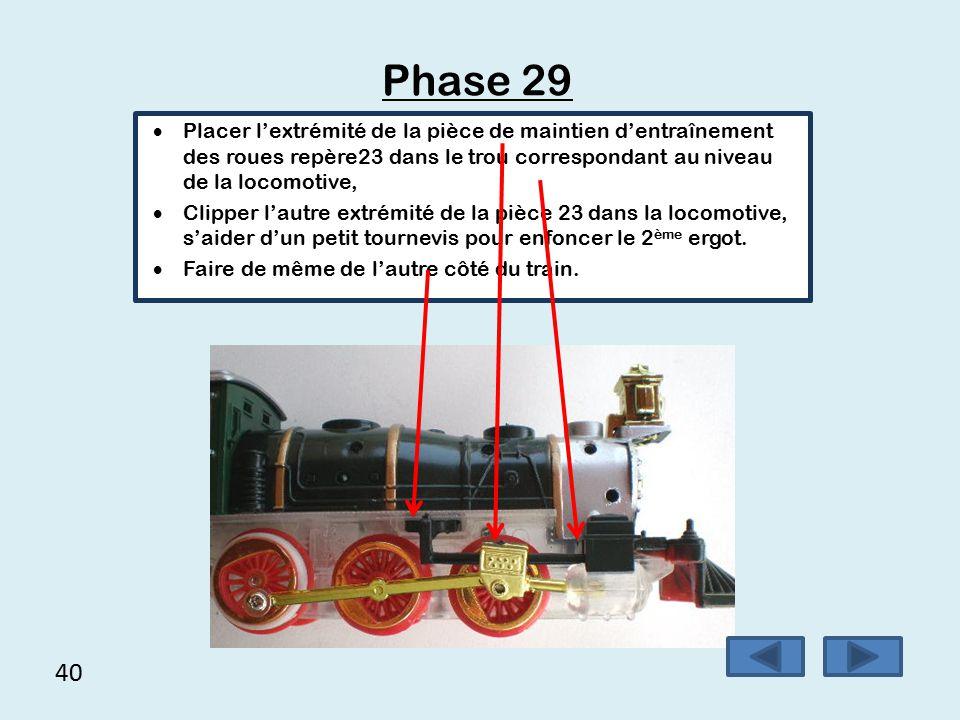39 Phase 28  Mettre en place la tige d'entrainement des roues repère13  Visser la pièce 13 sur la roue motrice avec une vis rondelle repère 37 Attention : ne pas trop serrer la vis pour ne pas empêcher la roue de tourner.