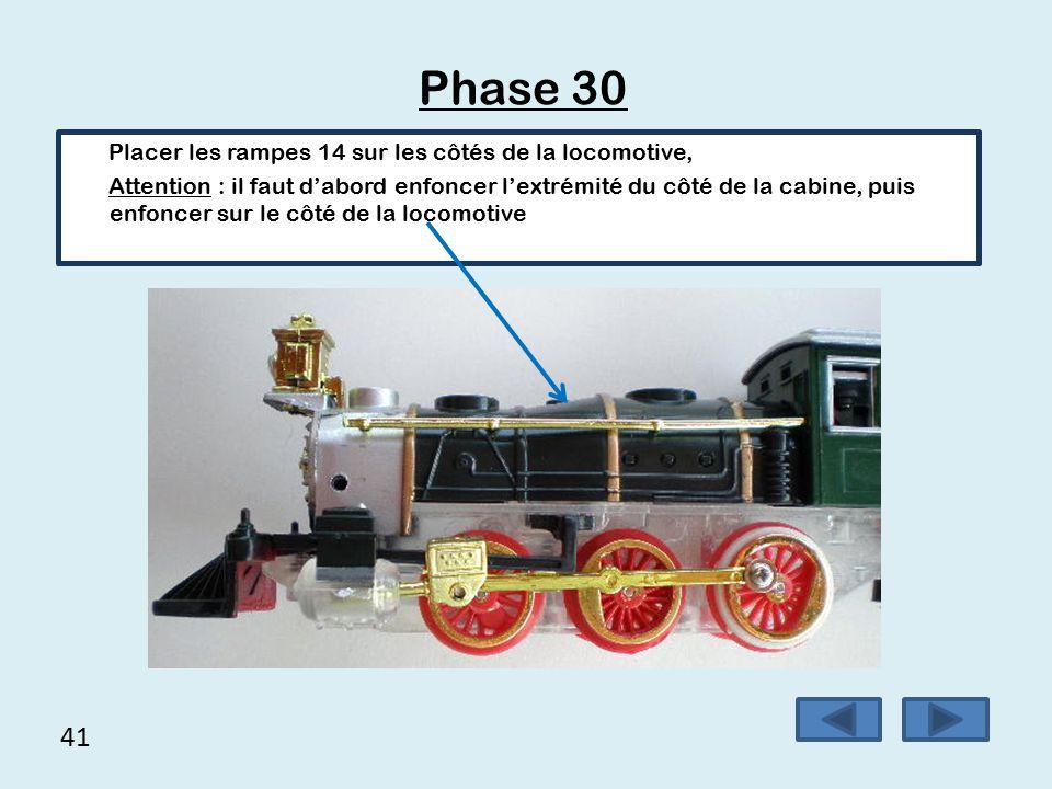 40 Phase 29  Placer l'extrémité de la pièce de maintien d'entraînement des roues repère23 dans le trou correspondant au niveau de la locomotive,  Clipper l'autre extrémité de la pièce 23 dans la locomotive, s'aider d'un petit tournevis pour enfoncer le 2 ème ergot.
