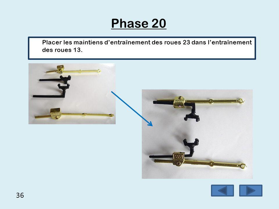 36 Phase 20 Placer les maintiens d'entraînement des roues 23 dans l'entraînement des roues 13.