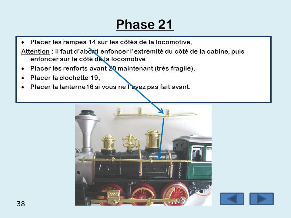 38 Phase 21  Placer les rampes 14 sur les côtés de la locomotive, Attention : il faut d'abord enfoncer l'extrémité du côté de la cabine, puis enfonce