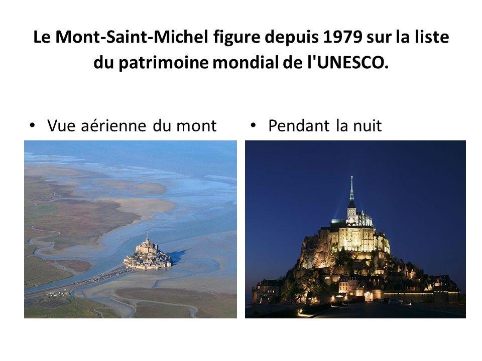 Le Mont-Saint-Michel figure depuis 1979 sur la liste du patrimoine mondial de l'UNESCO. Pendant la nuit Vue aérienne du mont