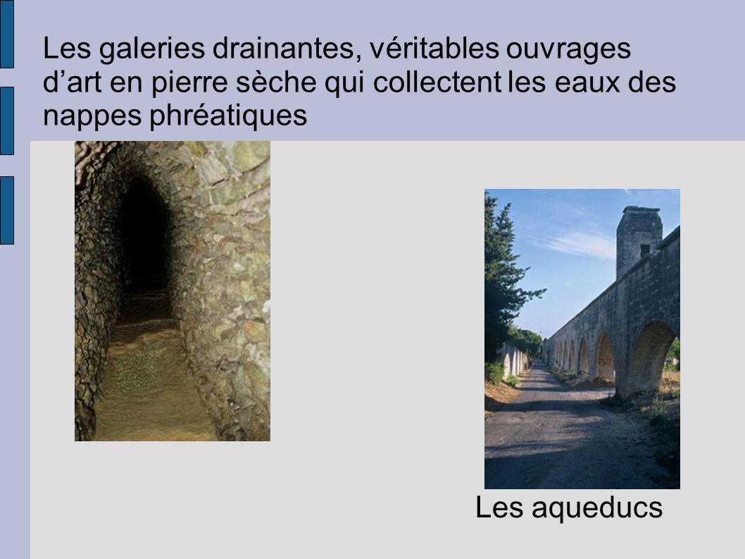 Les galeries drainantes, véritables ouvrages dart en pierre sèche qui collectent les eaux des nappes phréatiques Les aqueducs