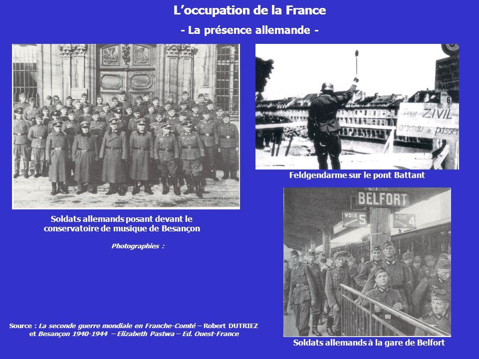 - La présence allemande - Soldats allemands posant devant le conservatoire de musique de Besançon Loccupation de la France Soldats allemands à la gare
