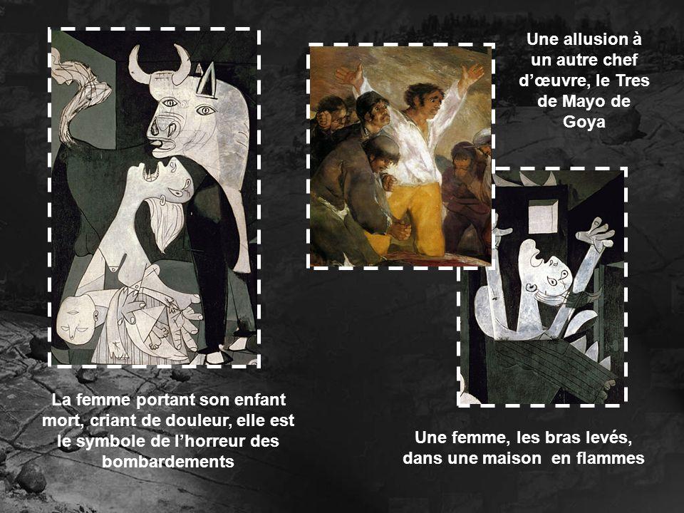 La femme portant son enfant mort, criant de douleur, elle est le symbole de lhorreur des bombardements Une femme, les bras levés, dans une maison en f