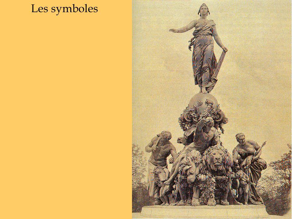 1.Marianne Allégorie de la République, drapée, un sein nu, bonnet phrygien, faisceau (de la Loi), main tendue.