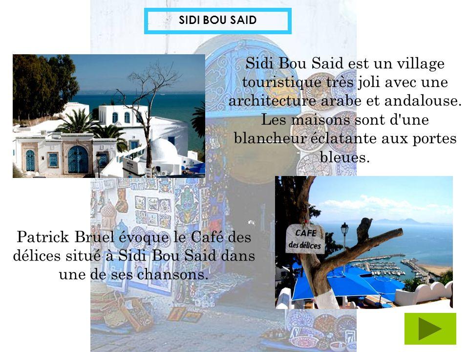 SIDI BOU SAID Sidi Bou Said est un village touristique très joli avec une architecture arabe et andalouse. Les maisons sont d'une blancheur éclatante