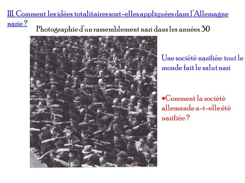 III. Comment les idées totalitaires sont-elles appliquées dans lAllemagne nazie ? Photographie dun rassemblement nazi dans les années 30 Une société n