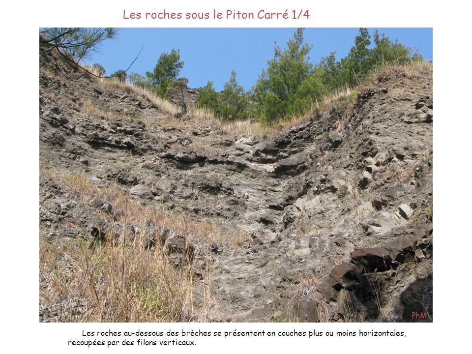 Les roches sous le Piton Carré 1/4 Les roches au-dessous des brèches se présentent en couches plus ou moins horizontales, recoupées par des filons ver