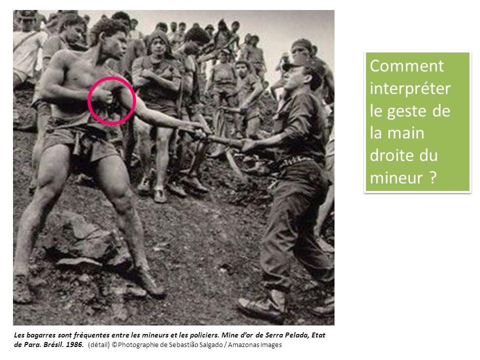 Comment interpréter le geste de la main droite du mineur ? Les bagarres sont fréquentes entre les mineurs et les policiers. Mine dor de Serra Pelada,