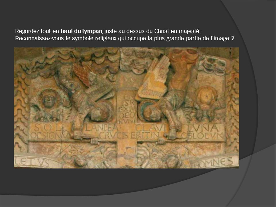 Regardez tout en haut du tympan, juste au dessus du Christ en majesté : Reconnaissez-vous le symbole religieux qui occupe la plus grande partie de lim