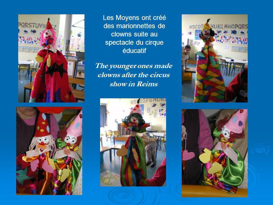 The younger ones made clowns after the circus show in Reims Les Moyens ont créé des marionnettes de clowns suite au spectacle du cirque éducatif