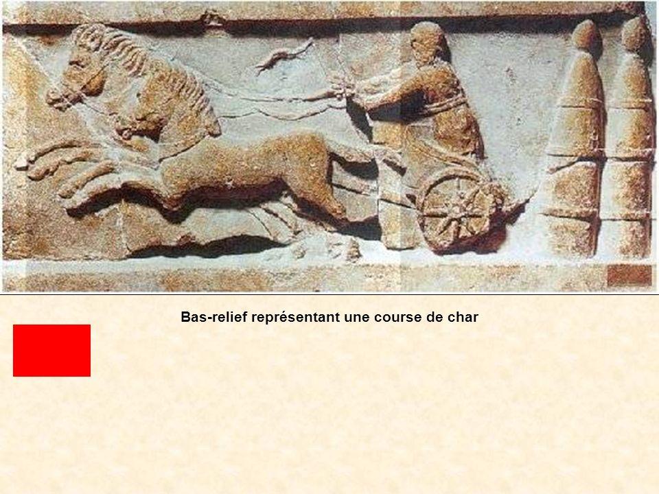 D9 Bas-relief représentant une course de char