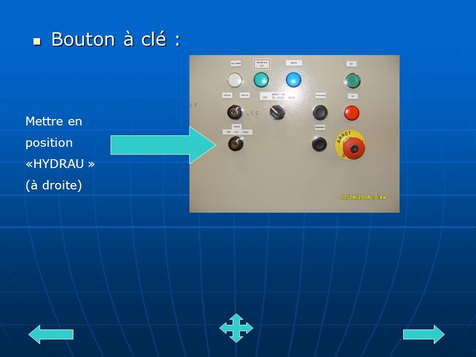 Bouton à clé : Bouton à clé : Mettre en position «HYDRAU » (à droite)
