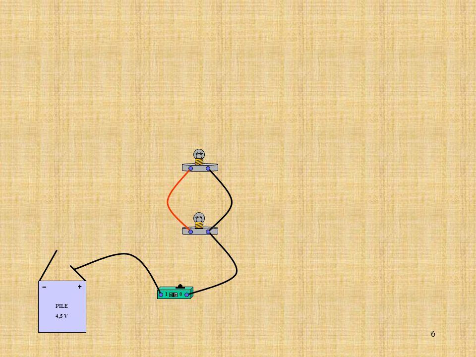 27 Relier la borne (COM) de lampèremètre à la borne de la lampe correspondant au coté (-) de la pile.