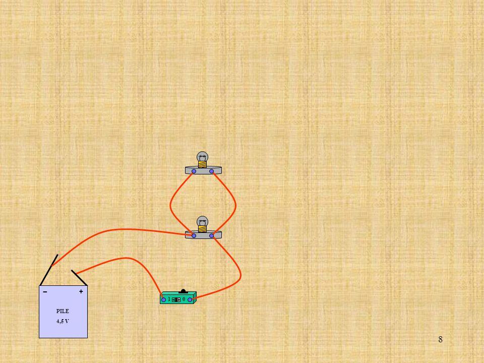 19 Relier la borne (COM) de lampèremètre à la borne de la lampe correspondant au coté (-) de la pile.