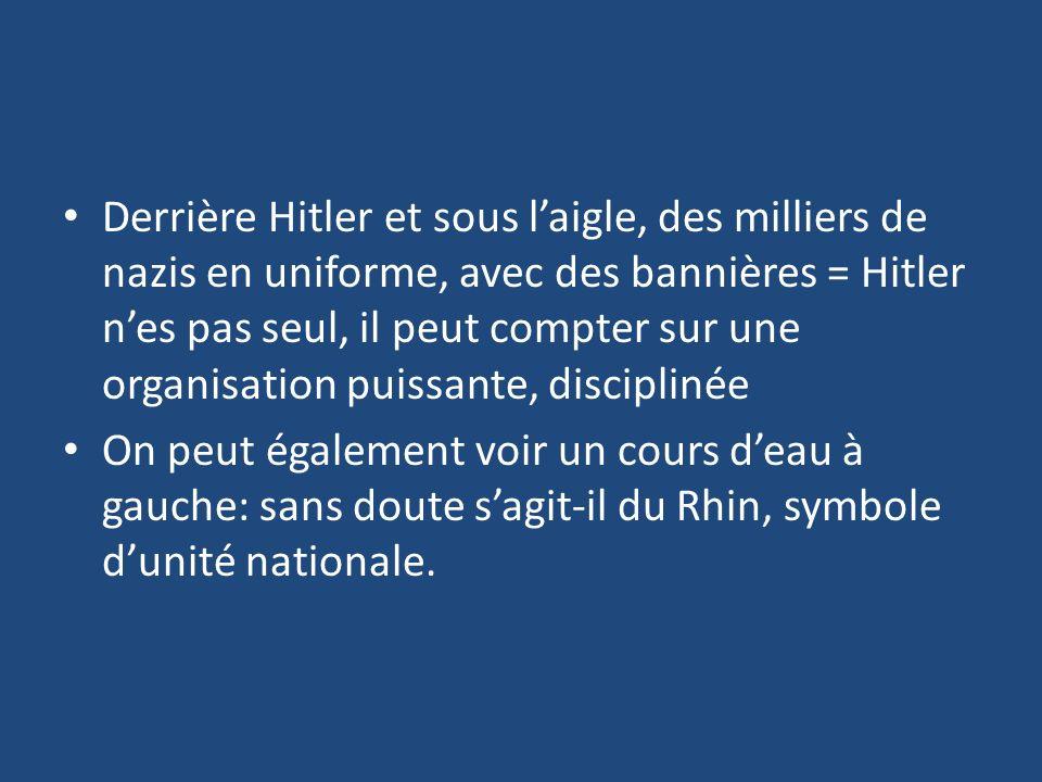 Derrière Hitler et sous laigle, des milliers de nazis en uniforme, avec des bannières = Hitler nes pas seul, il peut compter sur une organisation puis