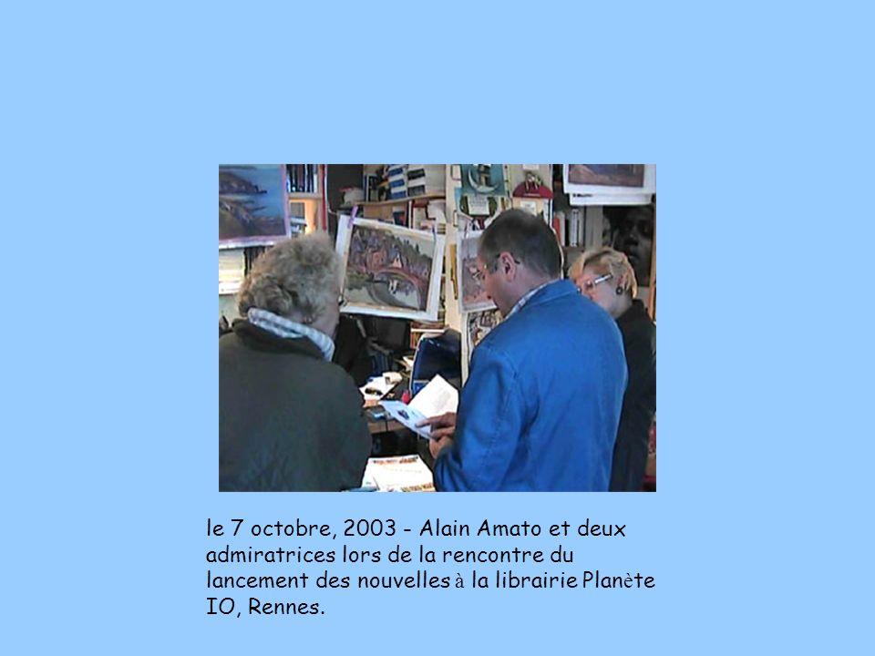 le 7 octobre, 2003 - Alain Amato et deux admiratrices lors de la rencontre du lancement des nouvelles à la librairie Plan è te IO, Rennes.