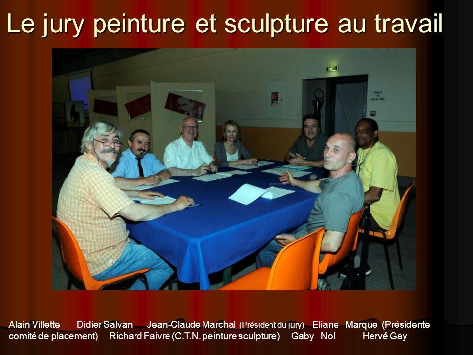 Le jury peinture et sculpture au travail Alain Villette Didier Salvan Jean-Claude Marchal (Président du jury) Eliane Marque (Présidente comité de plac