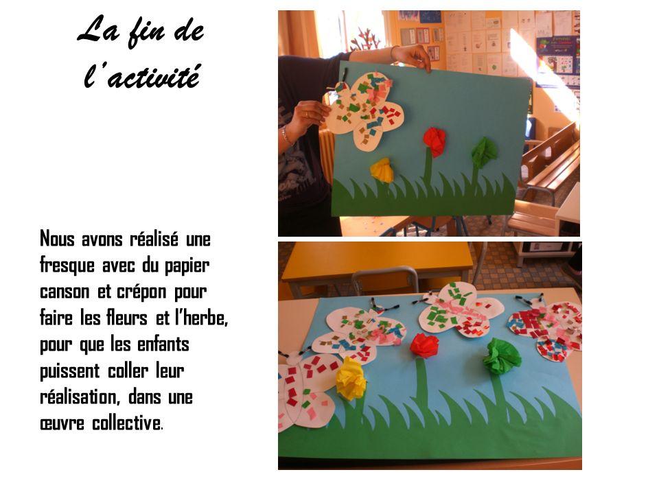 La fin de lactivité Nous avons réalisé une fresque avec du papier canson et crépon pour faire les fleurs et lherbe, pour que les enfants puissent coll