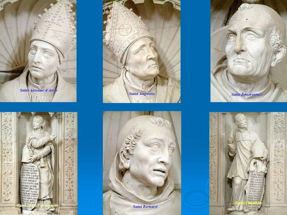 Les Théologiens Au-dessus de l'ensevelissement, 4 personnages en buste sont alignés. La tradition locale y reconnait saint Bernard, saint Anselme, sai