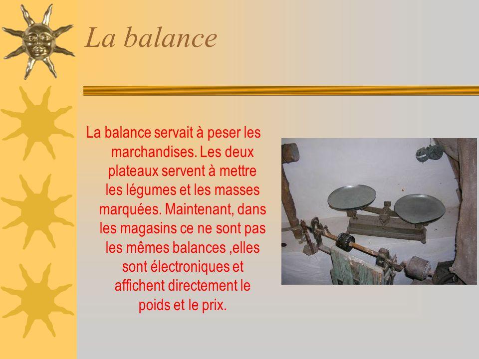 La balance La balance servait à peser les marchandises.
