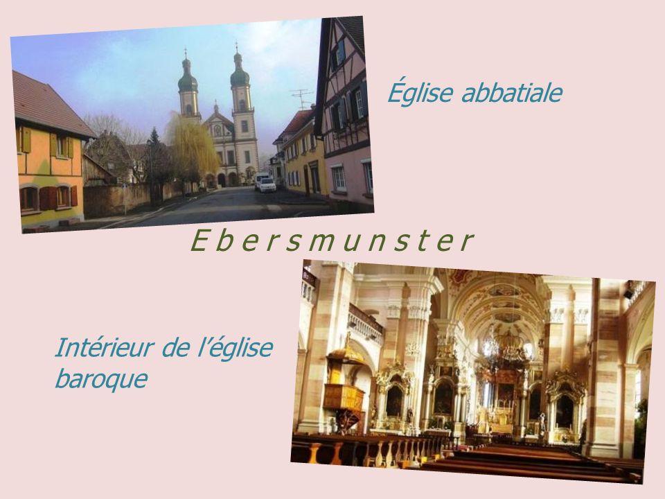 C h â t e n o i s. Église Saint-Georges, les vignes Tour des sorcières du XVe siècle La rue principale