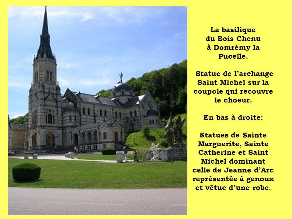 La basilique du Bois Chenu à Domrémy la Pucelle. Statue de larchange Saint Michel sur la coupole qui recouvre le choeur. En bas à droite: Statues de S