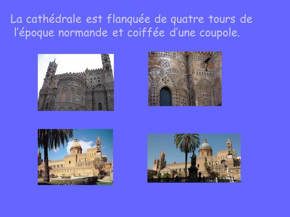 La cathédrale est flanquée de quatre tours de lépoque normande et coiffée dune coupole.