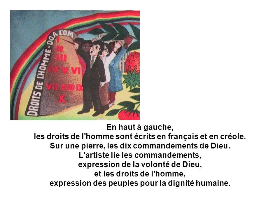En haut à gauche, les droits de l'homme sont écrits en français et en créole. Sur une pierre, les dix commandements de Dieu. L'artiste lie les command