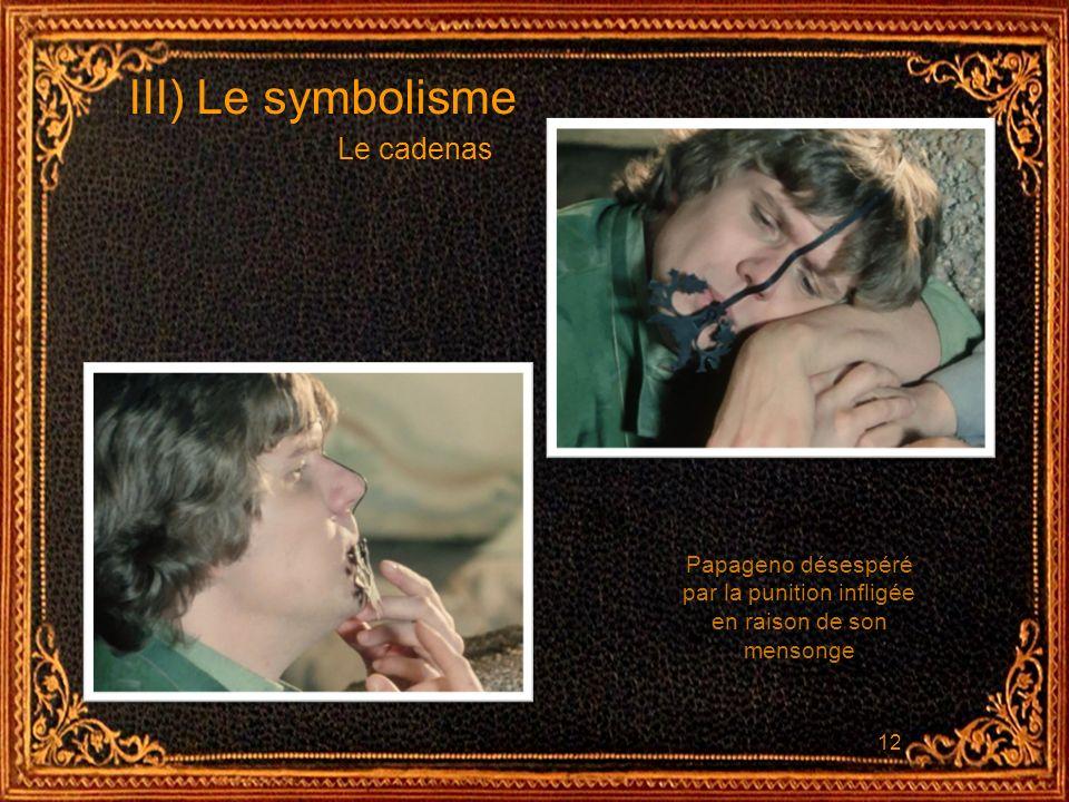 12 III) Le symbolisme Le cadenas Papageno désespéré par la punition infligée en raison de son mensonge