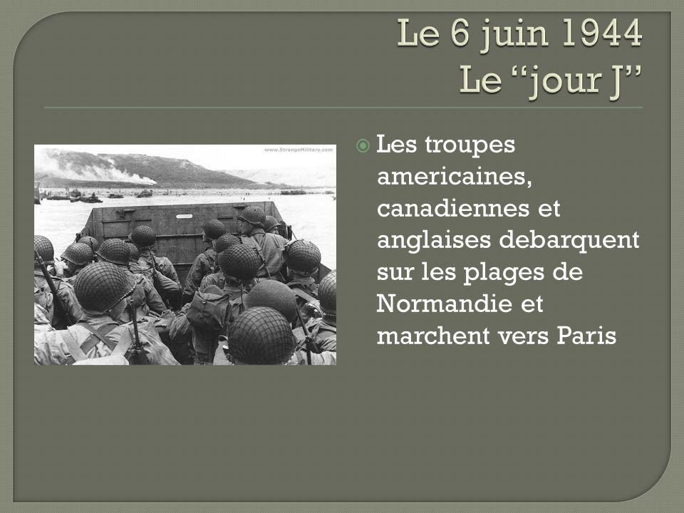 Les troupes americaines, canadiennes et anglaises debarquent sur les plages de Normandie et marchent vers Paris