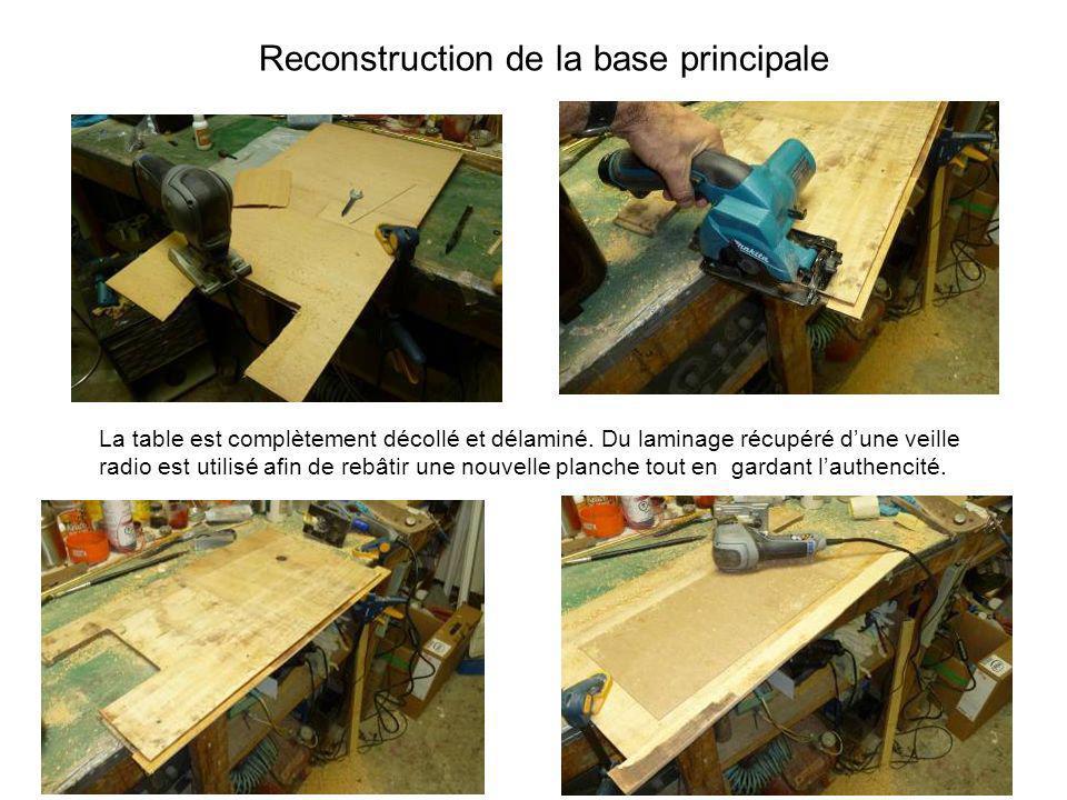 Reconstruction de la base principale La table est complètement décollé et délaminé. Du laminage récupéré dune veille radio est utilisé afin de rebâtir