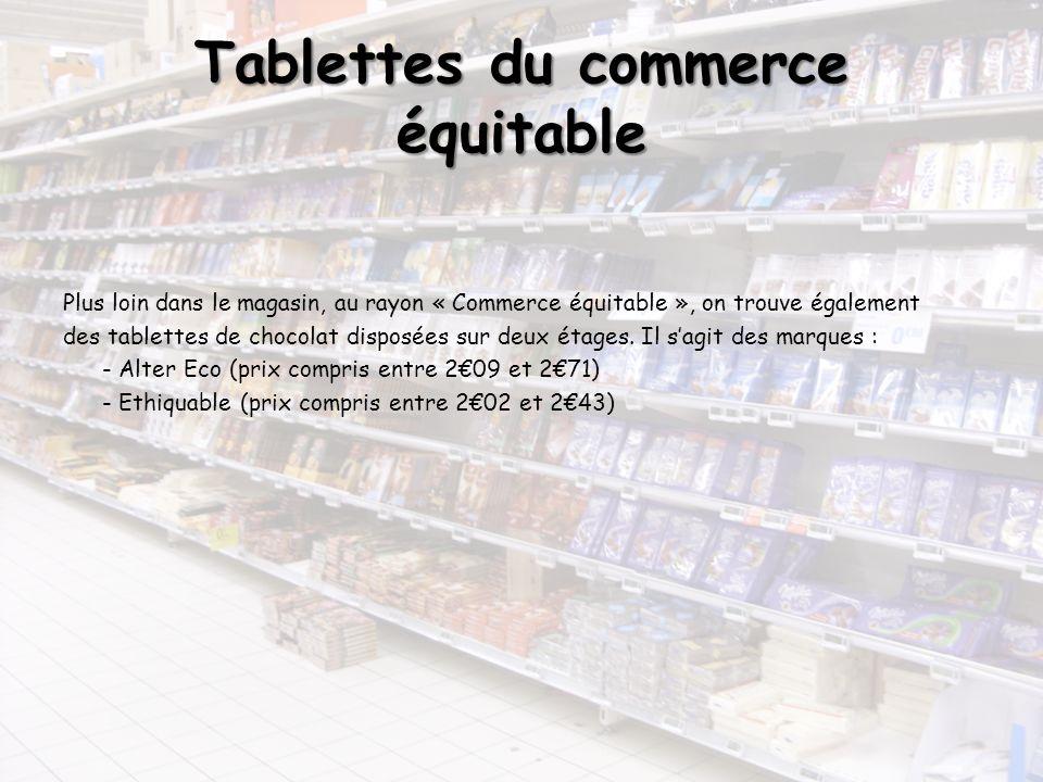 Tablettes du commerce équitable Plus loin dans le magasin, au rayon « Commerce équitable », on trouve également des tablettes de chocolat disposées su