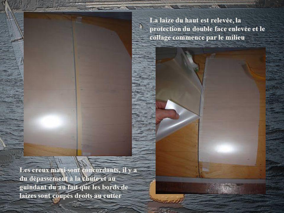 La laize du haut est relevée, la protection du double face enlevée et le collage commence par le milieu Les creux maxi sont concordants, il y a du dép