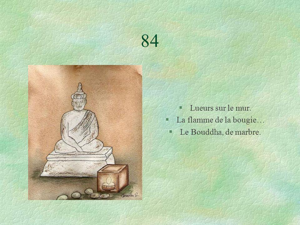 84 §Lueurs sur le mur. §La flamme de la bougie… §Le Bouddha, de marbre.