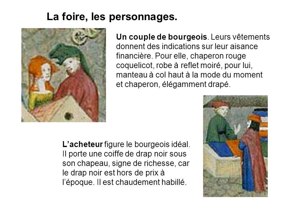 La foire, les personnages. Un couple de bourgeois. Leurs vêtements donnent des indications sur leur aisance financière. Pour elle, chaperon rouge coqu