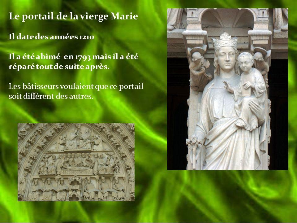 Le portail de la vierge Marie Il date des années 1210 Il a été abimé en 1793 mais il a été réparé tout de suite après. Les bâtisseurs voulaient que ce