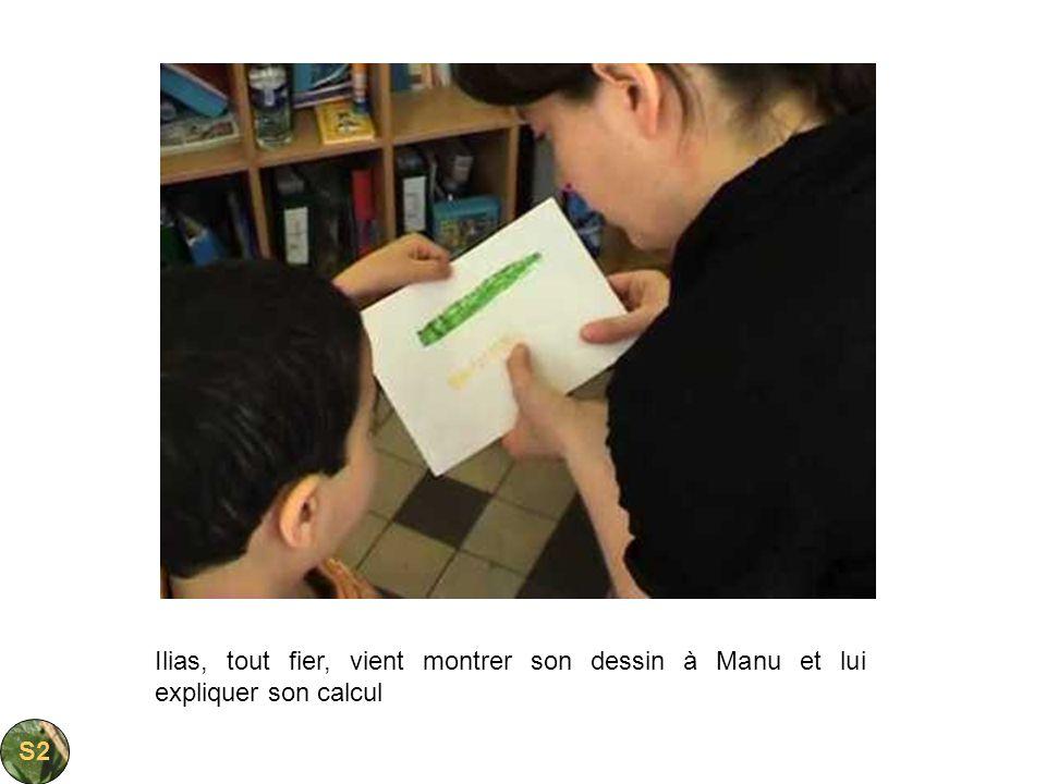 Ilias, tout fier, vient montrer son dessin à Manu et lui expliquer son calcul S2