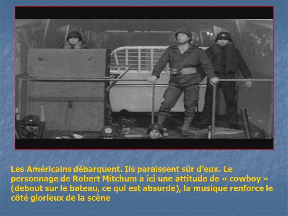 Les Américains ont atteint sans problème les plages, le capitaine joué par Robert Mitchum a encore une attitude sans peur et sans reproche, il exhorte ses troupes à avancer.