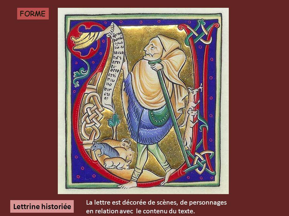 Lettrine historiée FORME La lettre est décorée de scènes, de personnages en relation avec le contenu du texte.